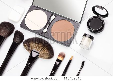 Set Of Various Makeup Brushes With Eyeshadows And Rouge