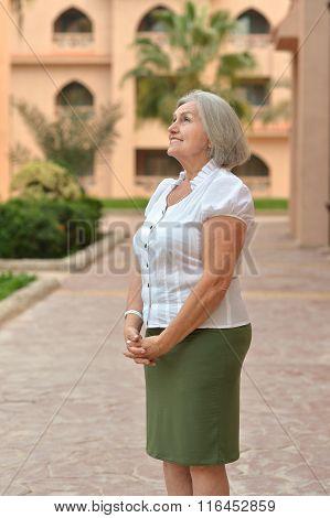 senior woman in near hotel