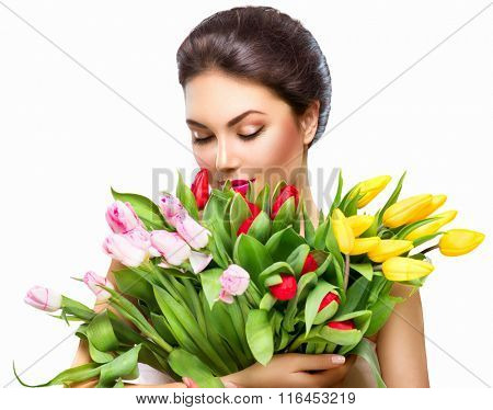 Beauty Woman with Spring Flower bouquet. Beautiful girl with a Bunch of colorful Tulip flowers. Happy surprised model woman smelling flowers. Valentine's Day. Mother's Day. Springtime