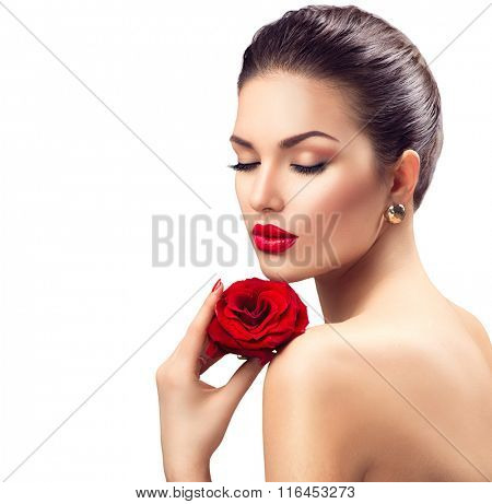 Beauty Woman with Red Rose flower. Red Lips and Nails. Beautiful Luxury Makeup and Manicure. Fashion Model Girl Portrait Isolated on a white background