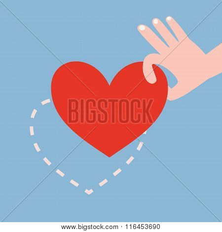 Hand Picking Up Red Heart On Blue Background