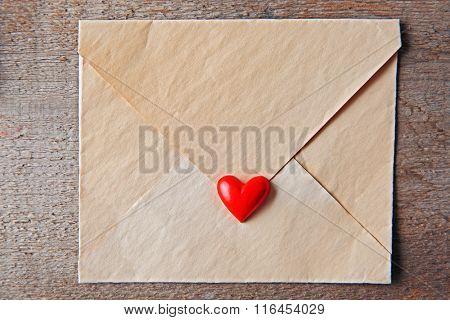 Blank present Valentine envelope on wooden background