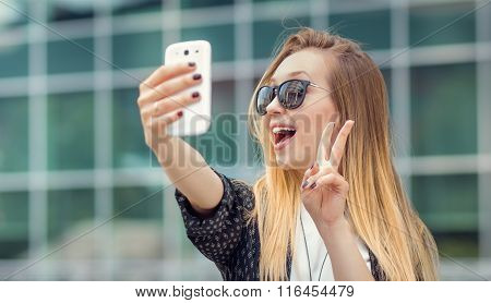 Trendy Girl Makes A Selfie