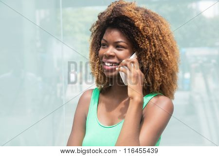 African American Girl With Amazing Hairstyle Speaking At Phone