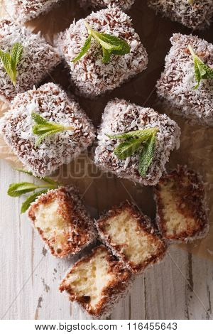 Freshly Baked Cakes Lamington Close-up On The Table. Vertical Top View