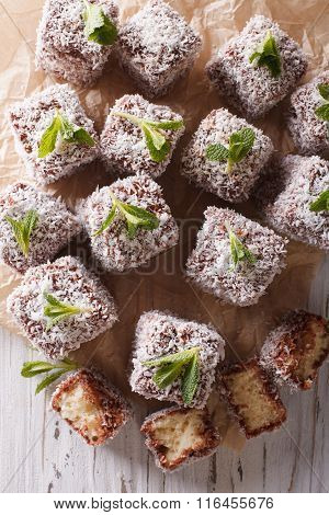 Lamington Cake With Coconut Close-up On. Vertical Top View