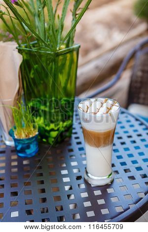 Caramel Cappuccino Coffee Glass On Table In Cafe