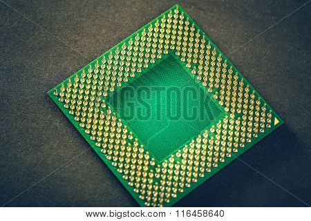 Computer processor on brown background