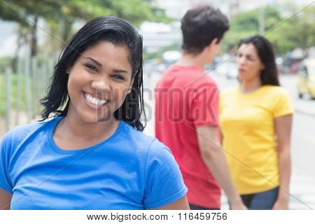 Happy Mexican Woman In A Blue Shirt With Friends