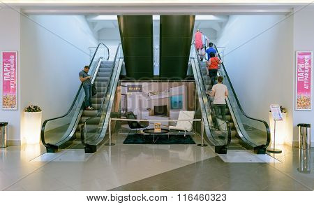 People Climb And Descend On The Escalator In Shopping Center Auchan