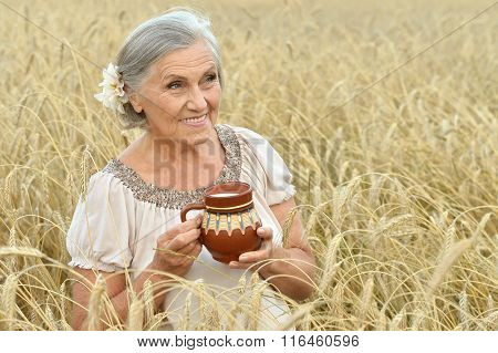 Senior woman resting at summer field
