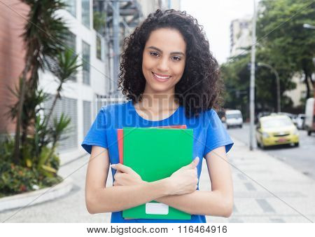 Lucky Caribbean Student With Books In The City