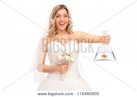 Young blond bride holding wedding flowers and a goldfish in a plastic bag isolated on white background