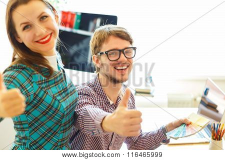 Beautiful Young Woman And Man With Thumb Up In Office