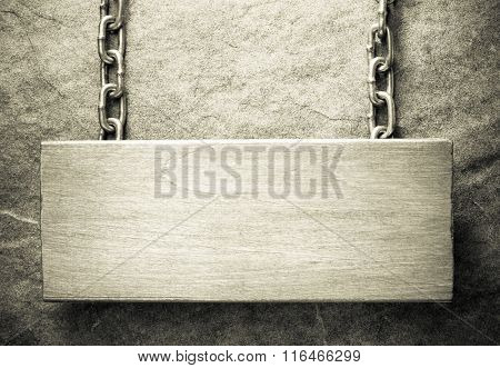hanging signboard at wall background