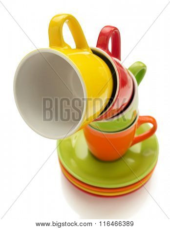 empty ceramic cup and saucer isolated on white background