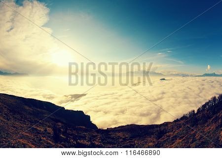 beautiful sunrise and clouds on mountain summits landscape