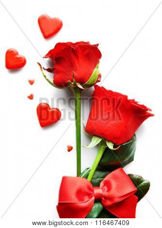 Beautiful rose with small hearts on white background