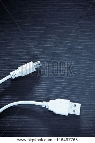 usb cable on wooden table