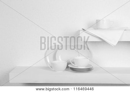 Tableware with napkin on a white background
