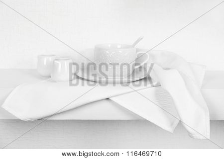 Tableware with napkin on a white background, close up