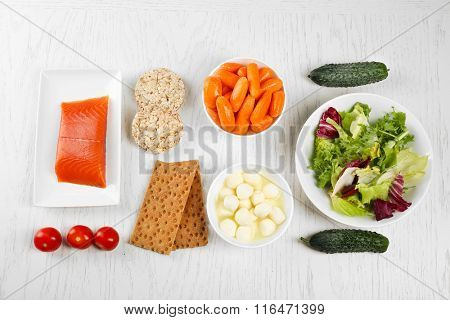 Healthy foods on light wooden background. healthy eating concept.