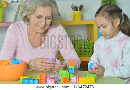 Grandmother with granddaughter playing together