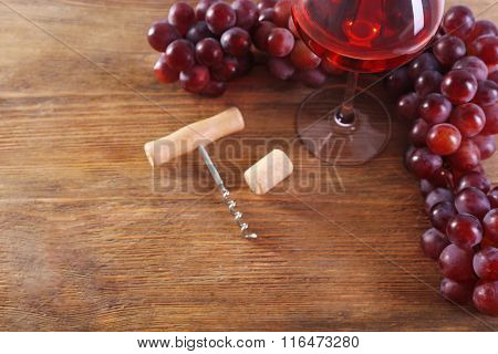 Wine and grapes on wooden background