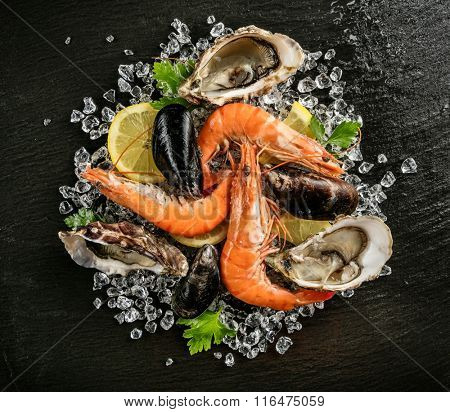Seafood served on black stone