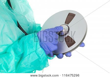 Female Doctor With Stethoscope And Tape
