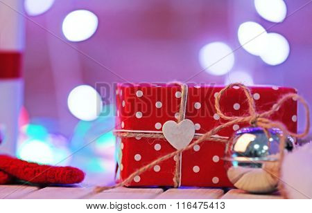Christmas gift boxes and bubble on blurred wall background