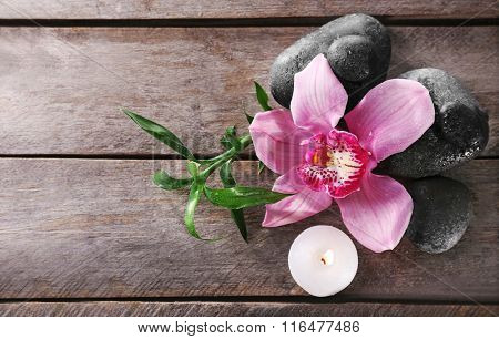 Spa still life with beautiful flower and candlelight on wooden background