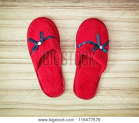 Red Slippers With Blue Ribbon On The Wooden Background, Retro Style