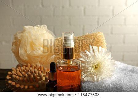 Variety of natural bath tools on bricks wall background