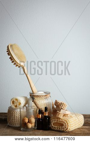 Variety of natural bath tools on wooden table