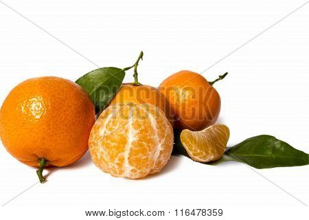 Single Mandarin With Leaves And Slices Isolated On White