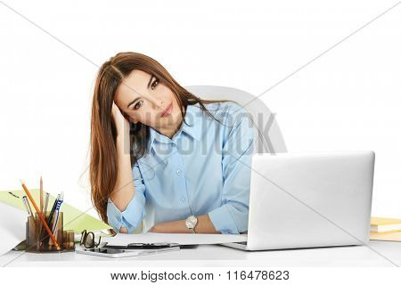 A beautiful tired woman working at the office, isolated on white