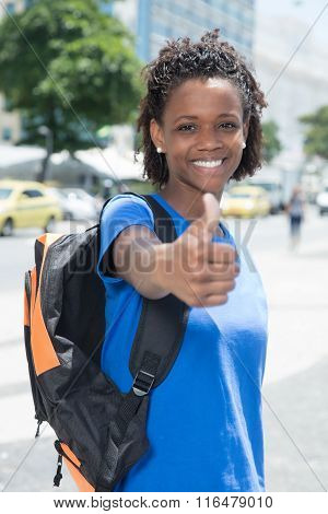African American Female Student In The City Showing Thumb Up