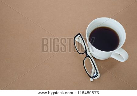 Office Desk With Coffee Cup With Blank And White Glasses.