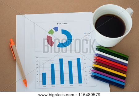 Business Report Information With Coffee Cup.