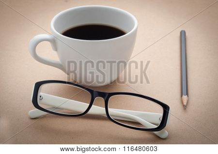 Office Desk With Black And White Glasses ,coffee Cup.