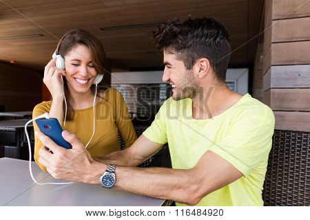 Man showing interest thing on cellphone with his friend