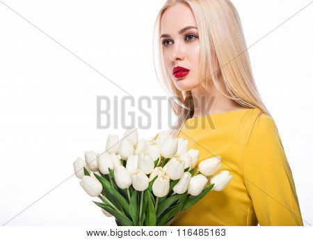 Portrait of  beautiful fashion model with bouquet  lily in hands, sweet and sensual. Beauty makeup,