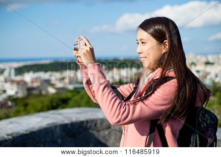 Woman take picture by digital camera