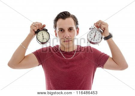 Young Man Is Holding Two Alarm Clocks