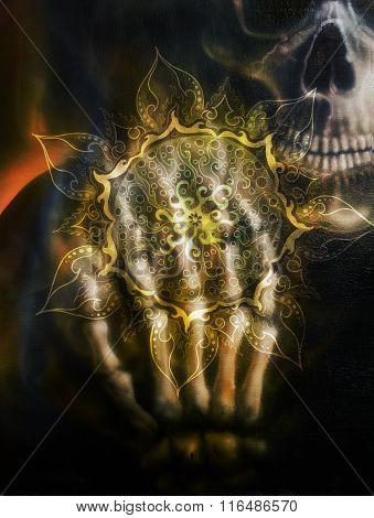 Painting  skull and skeleton hand, on black background and ornamental mandala. Airbrush painting.