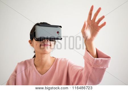 Woman play game with virtual reality glasses