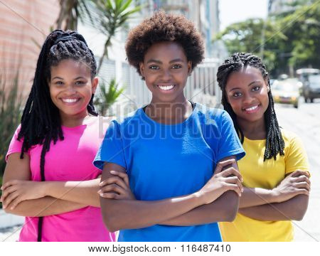 Three Laughing African American Girlfriends In The City