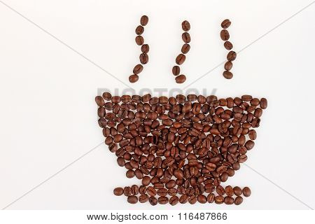 Roasted coffee beans in the shape of a cup and saucer