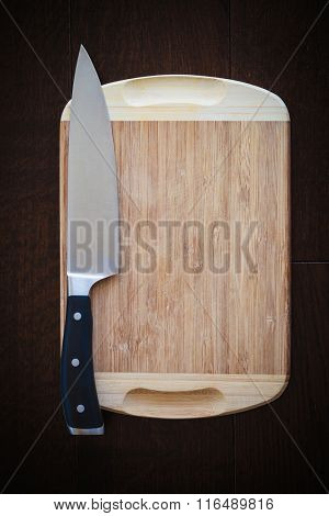 8 inch chef's knife on a cutting board, ready to cook concept